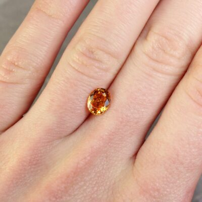 1.41 ct yellowish orange oval sapphire