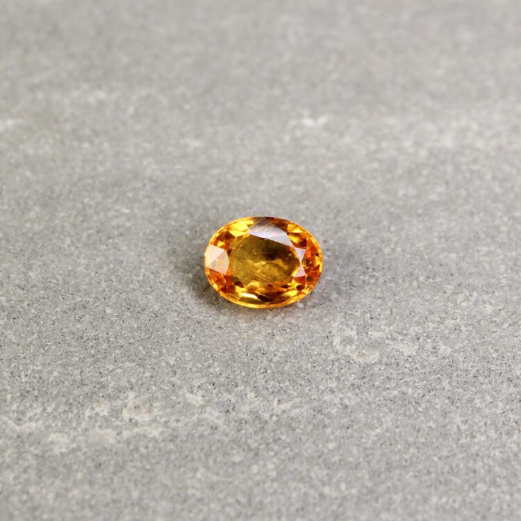 1.47 ct yellowish orange oval sapphire