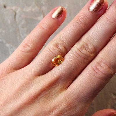 1.81 ct orangy yellow oval sapphire