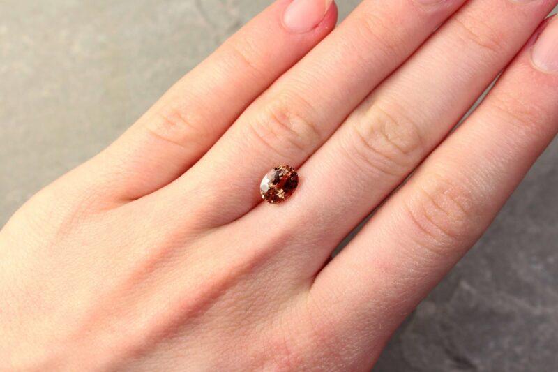 2.15 ct yellowish orange oval sapphire