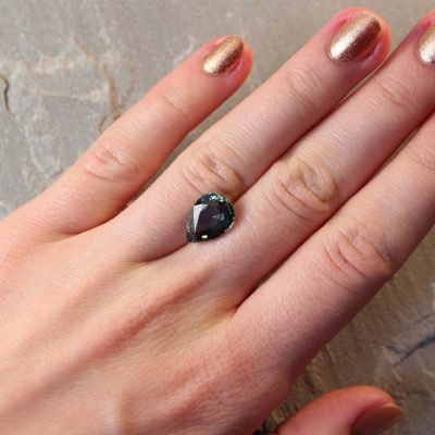 4.98 ct brownish green pear shape sapphire