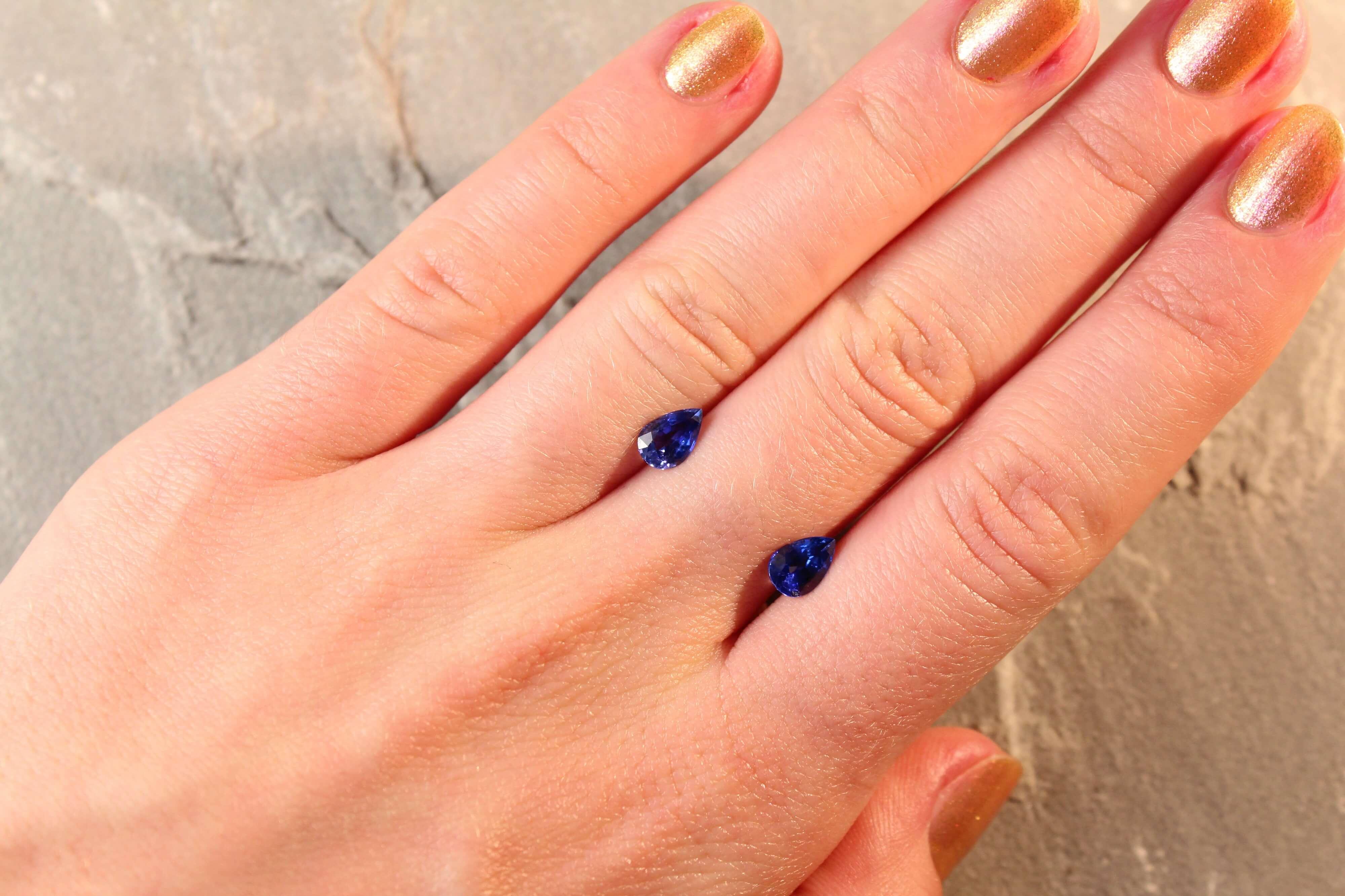 1.74 ct blue pear shape sapphire pair