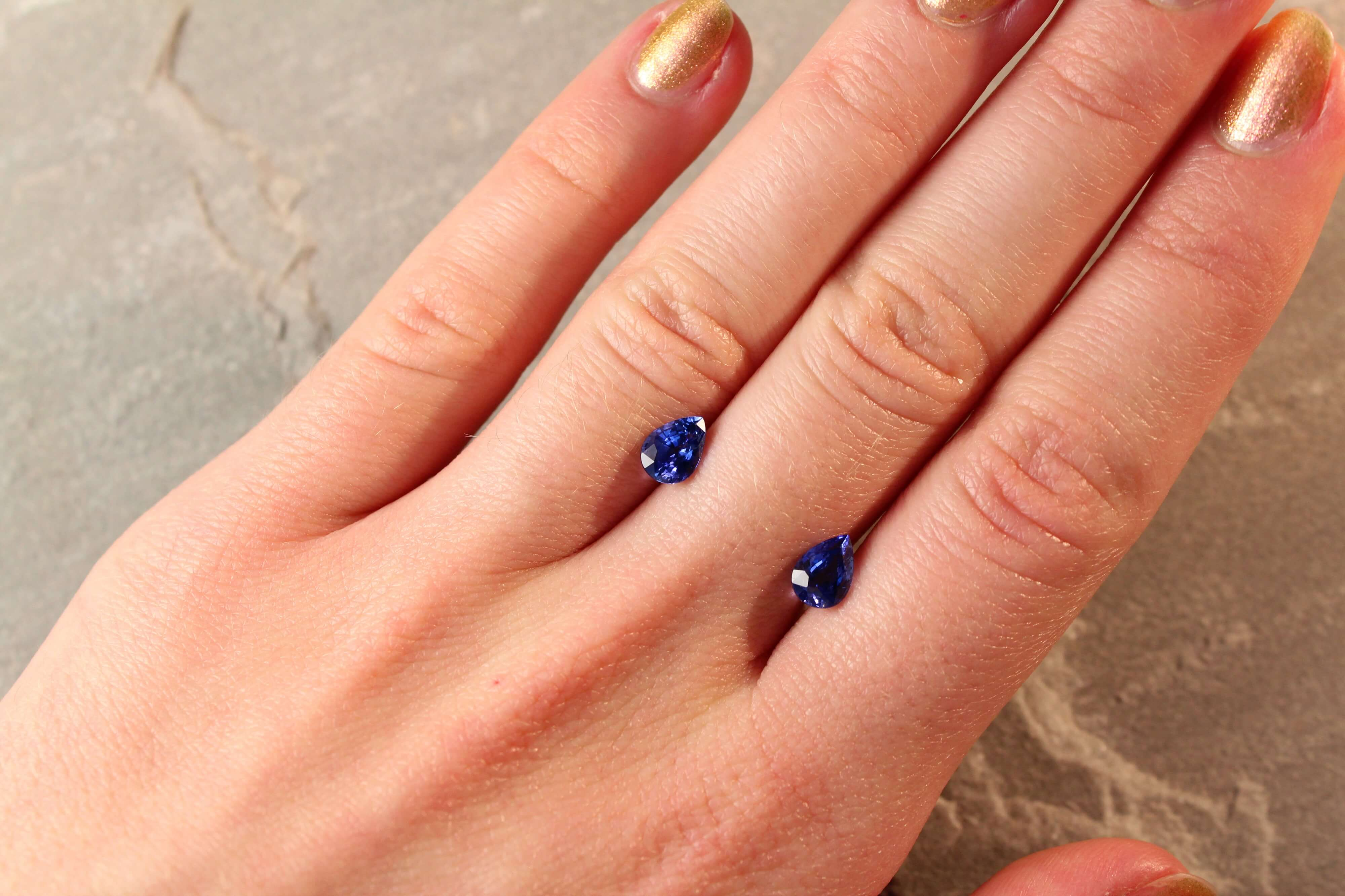2.09 ct blue pear shape sapphire pair