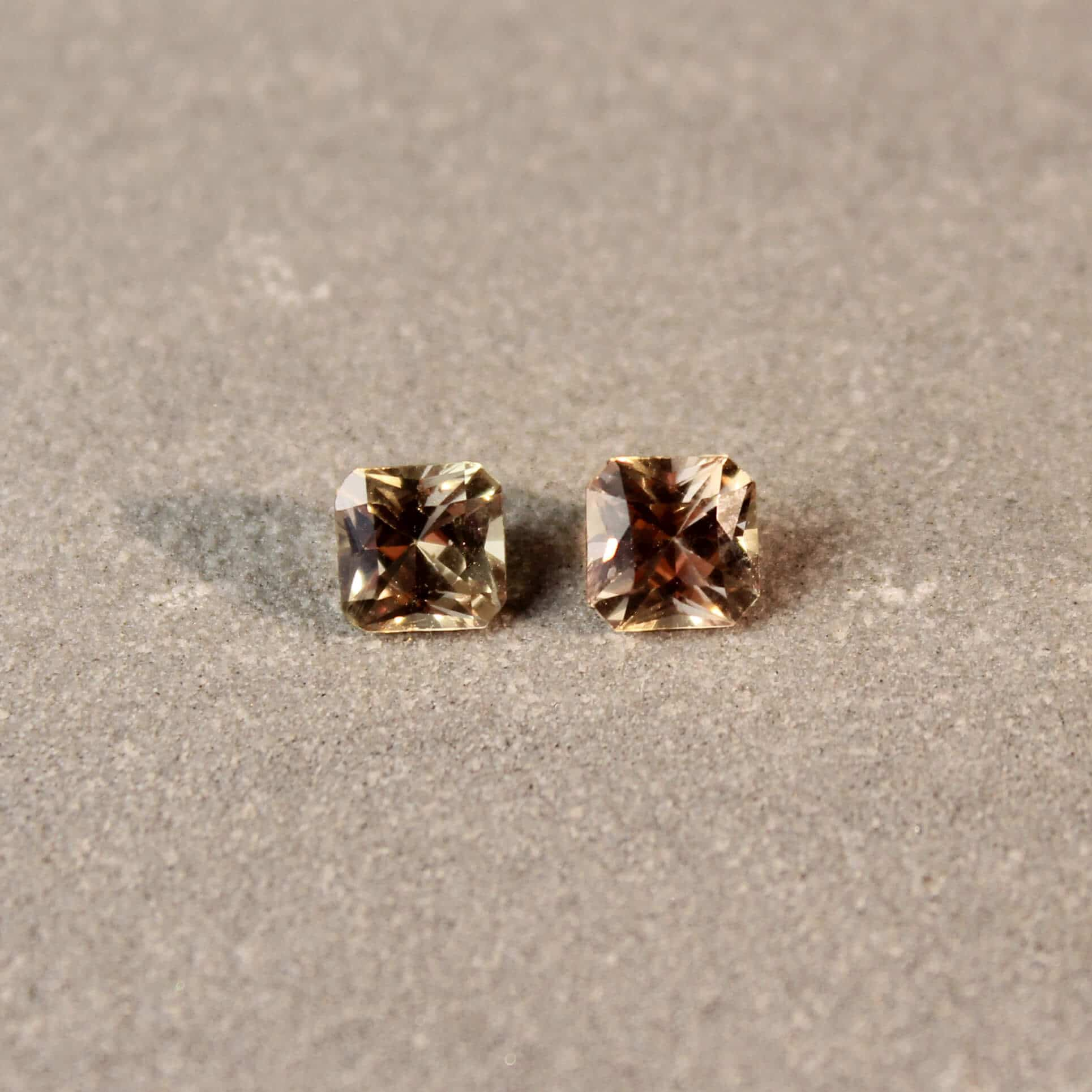 1.29 ct brownish yellow radiant sapphire pair