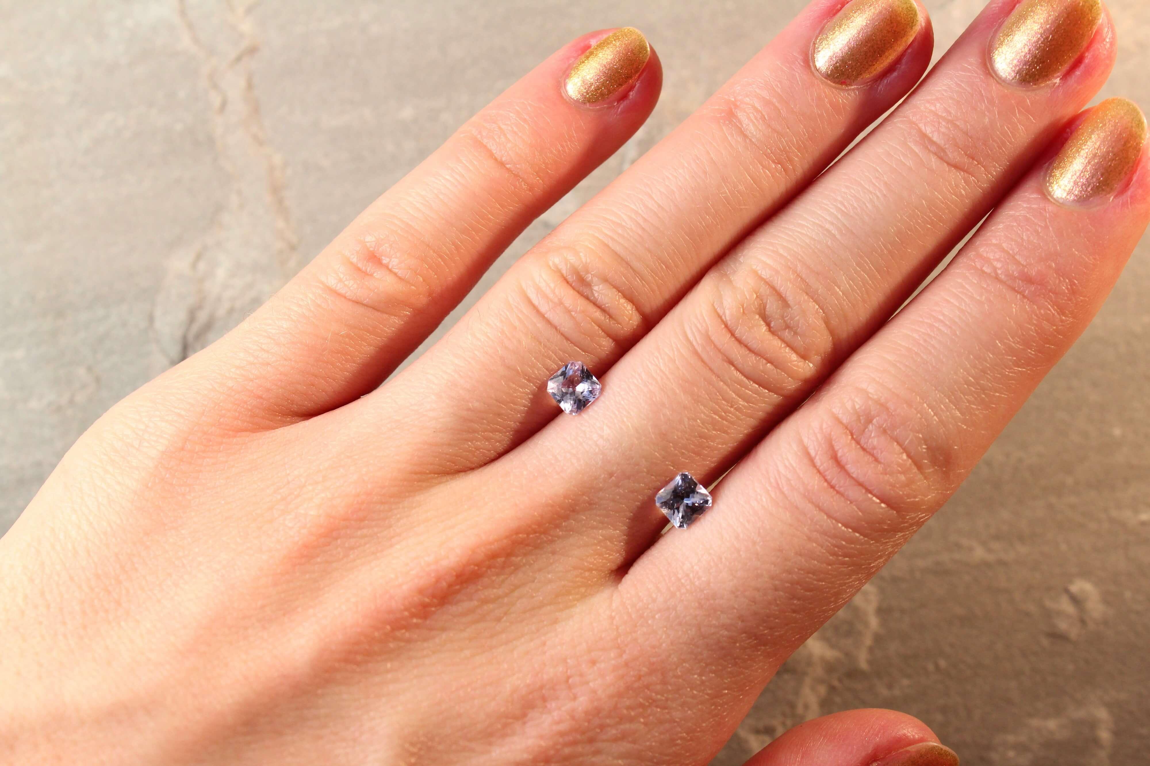 1.30 ct purplish blue radiant sapphire pair