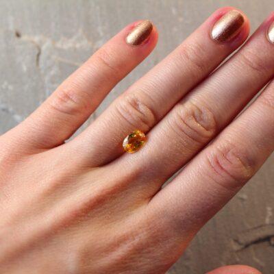 1.82 ct yellowish orange oval sapphire