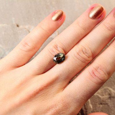 3.67 ct yellowish brownish green oval sapphire