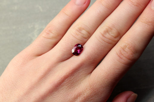 2.12 ct red cushion ruby hand