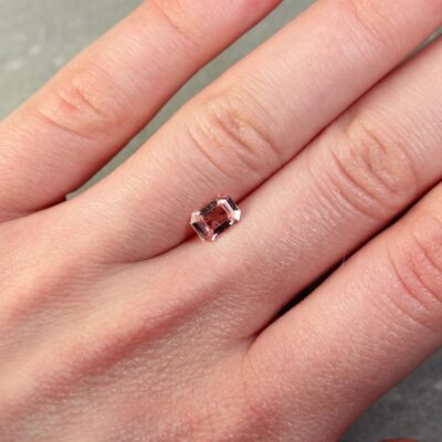 0.95 ct orangy pink padparadscha emerald cut sapphire