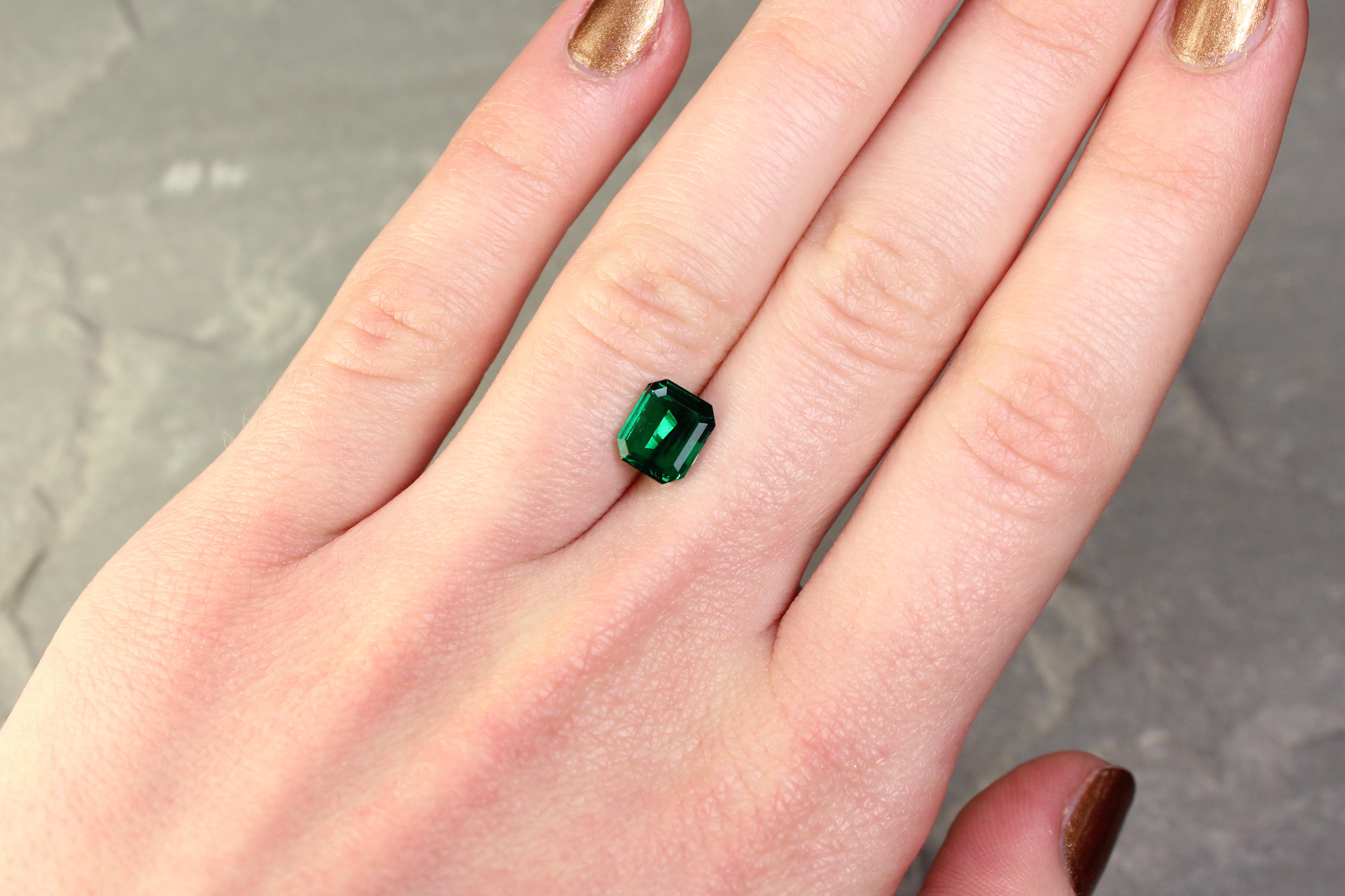 1.27 ct dark bluish green octagon emerald