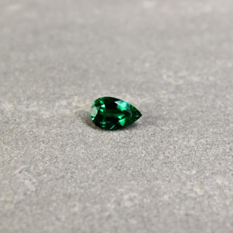 0.53 ct green pear shape emerald