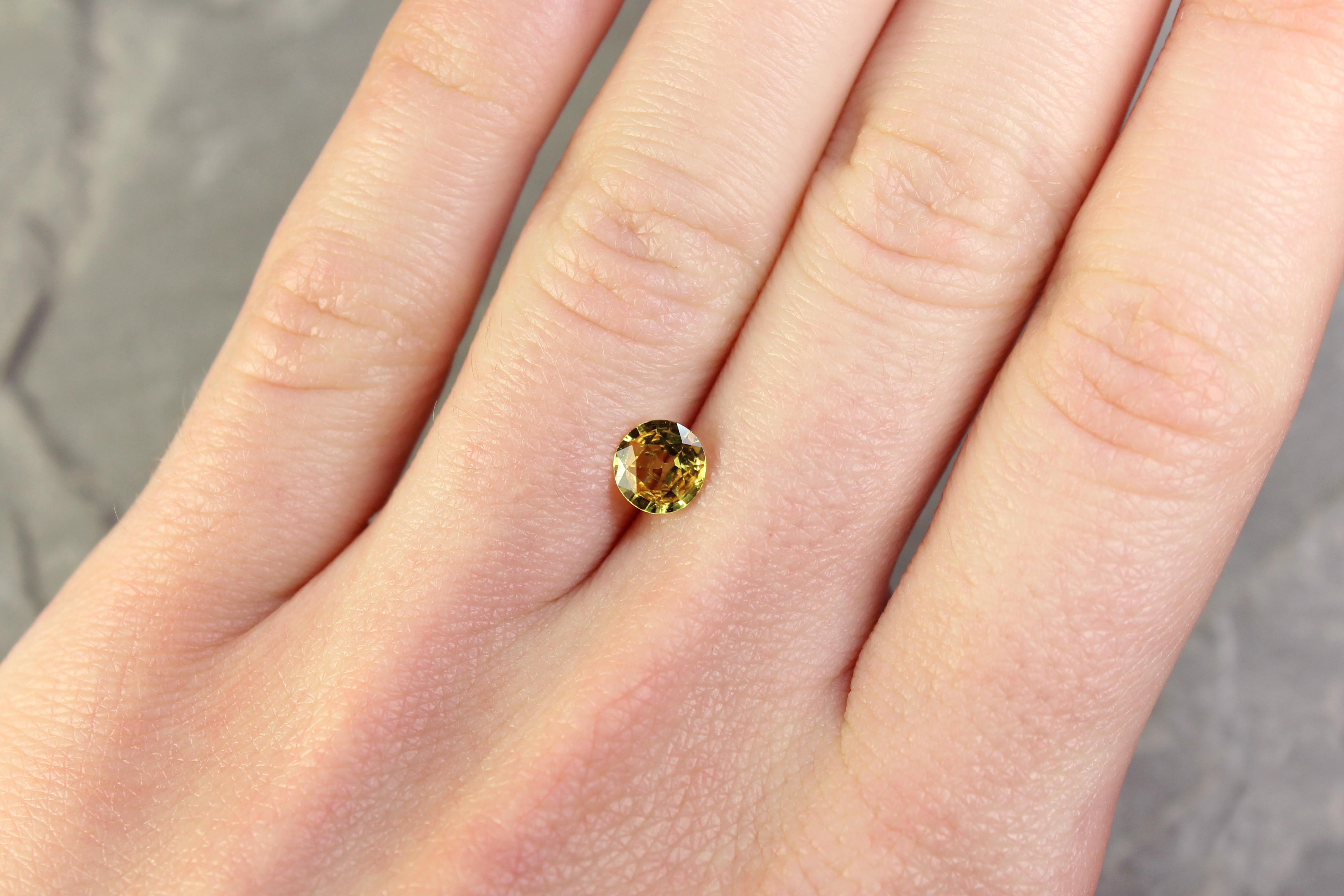 0.87 ct round yellow sapphire