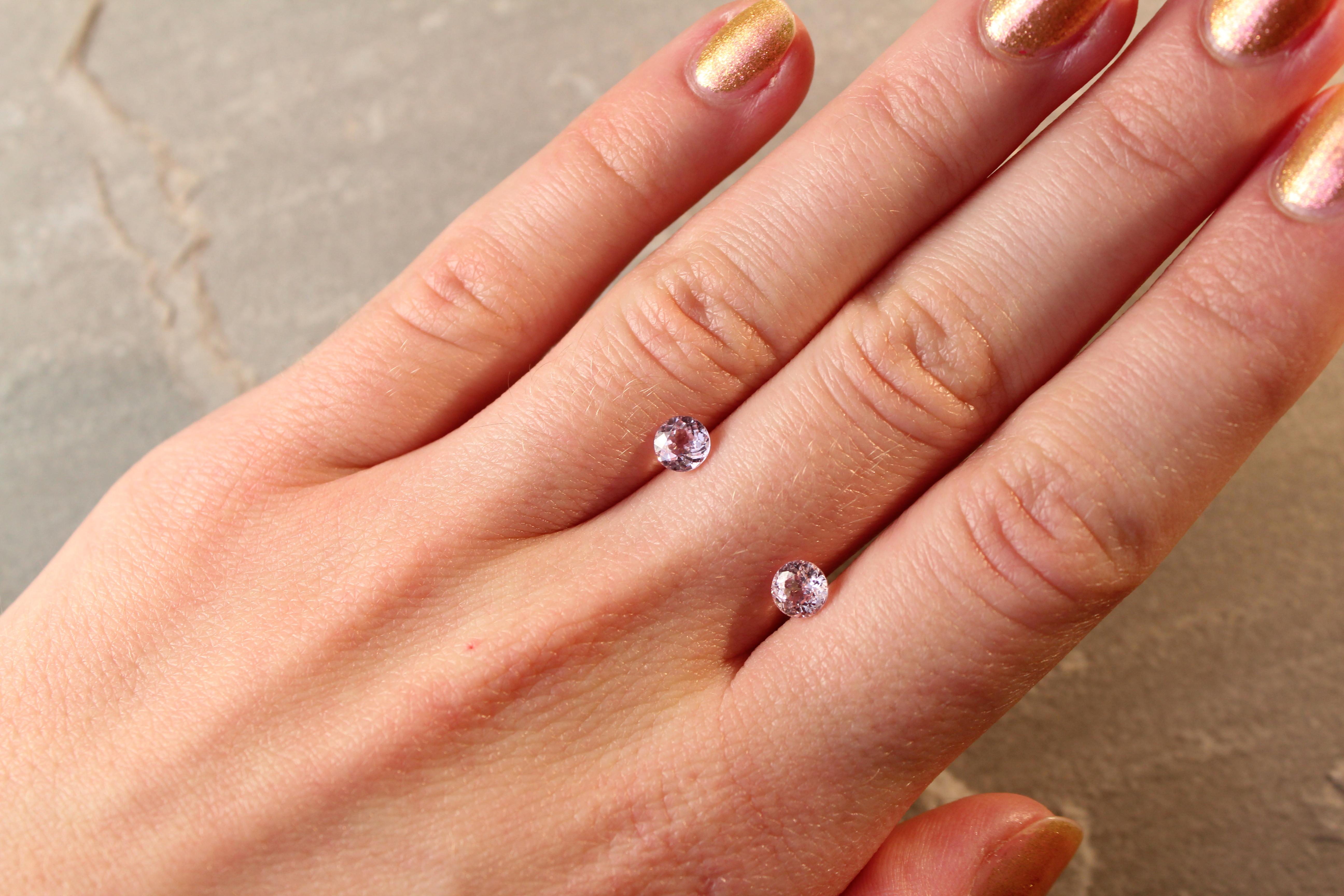 1.32 ct round orangy pink sapphire pair