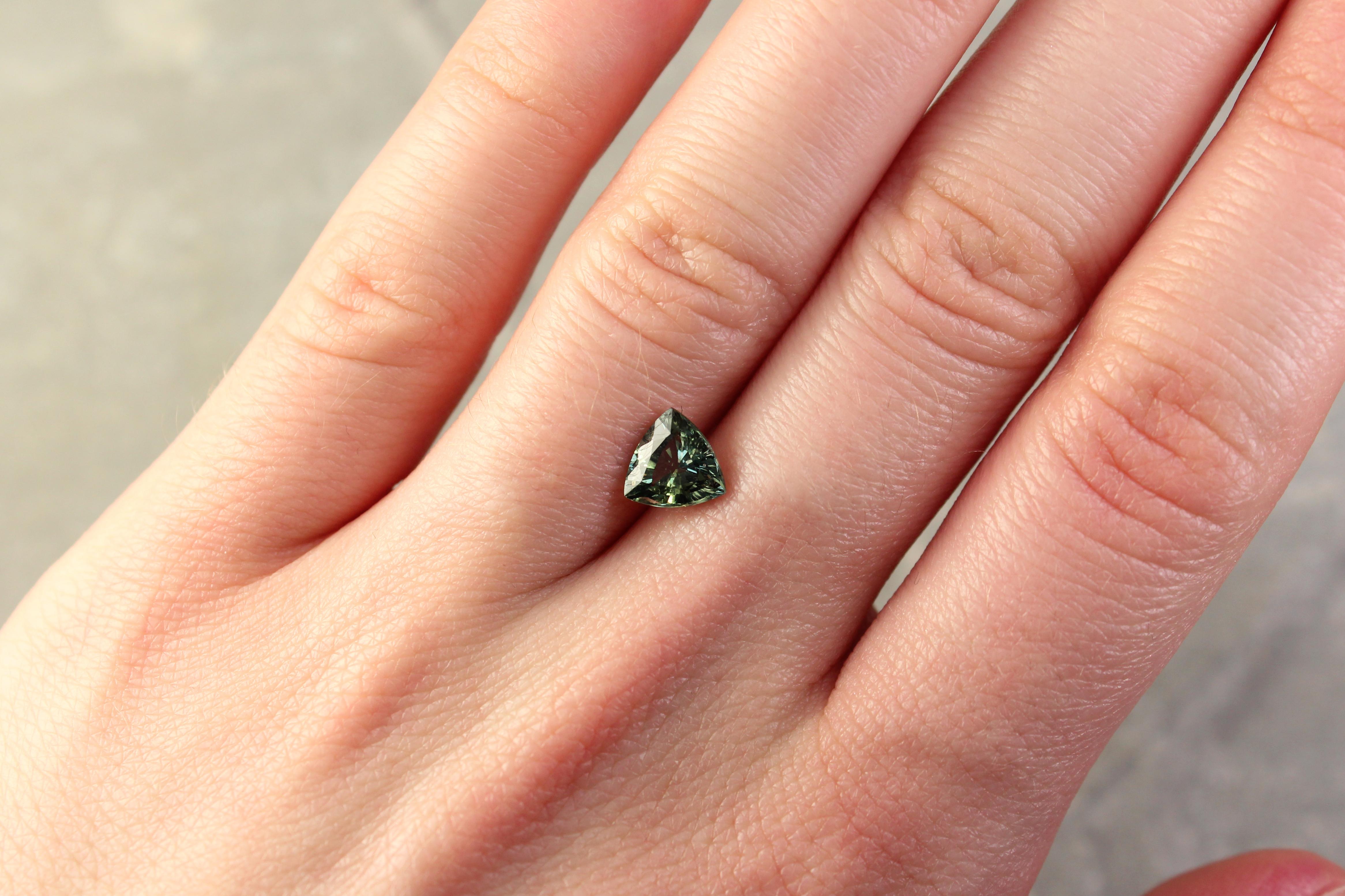 1.45 ct trilliant green sapphire