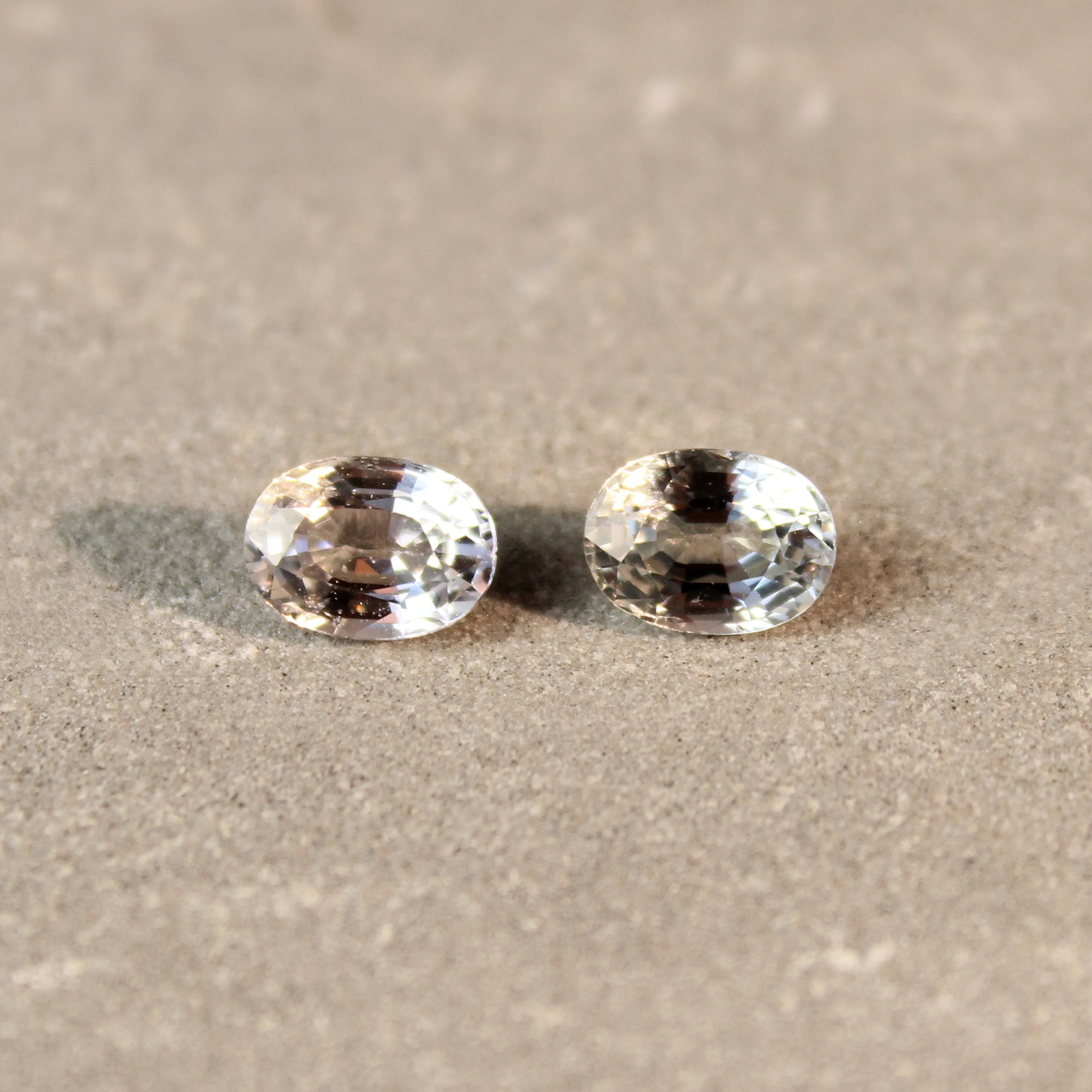 2.23 ct oval green sapphire pair