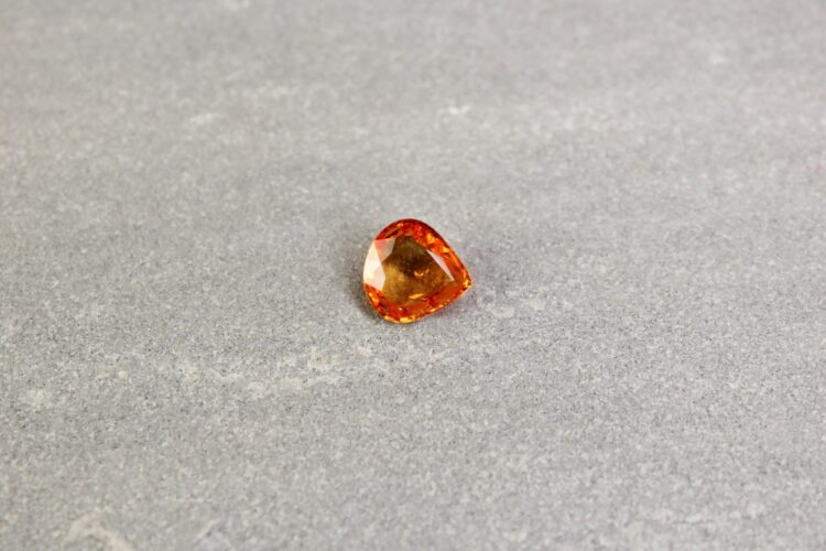 1.92 ct pear shape orange sapphire