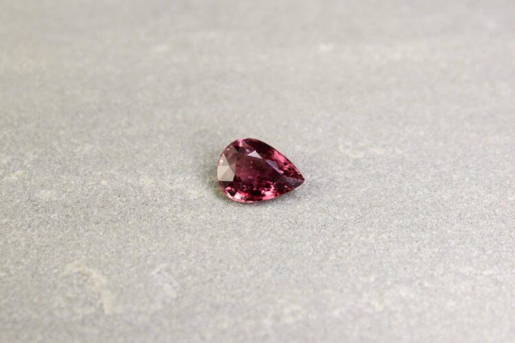 2.30 ct orangy purple pear shape sapphire