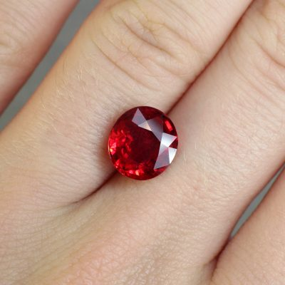 3.07 ct orangy red oval ruby