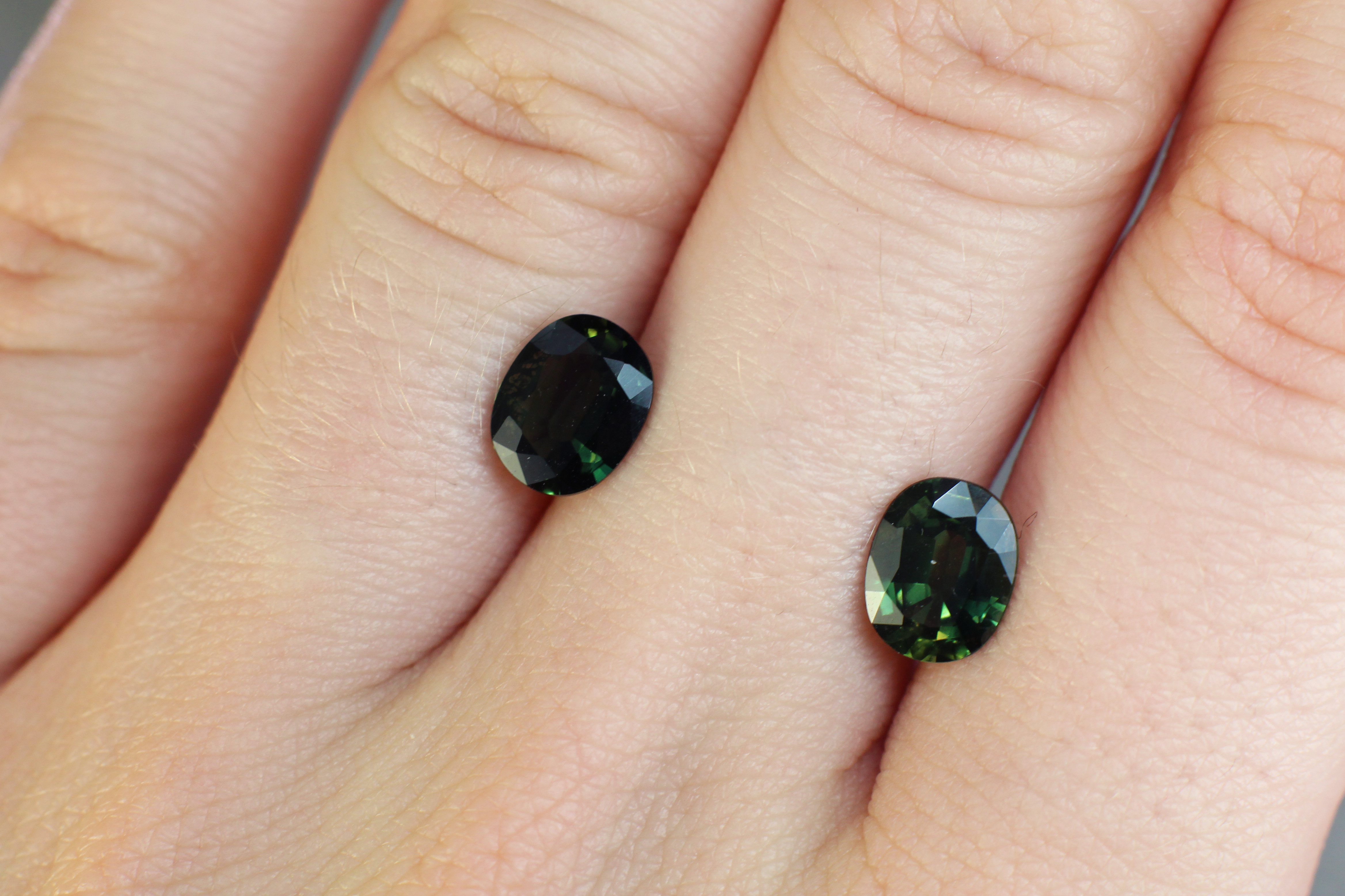 2.98 ct green oval sapphire pair