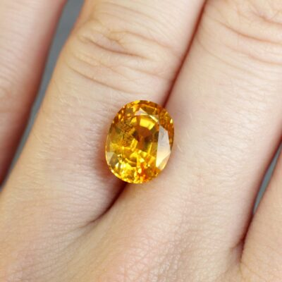 5.11 ct orangy yellow oval sapphire