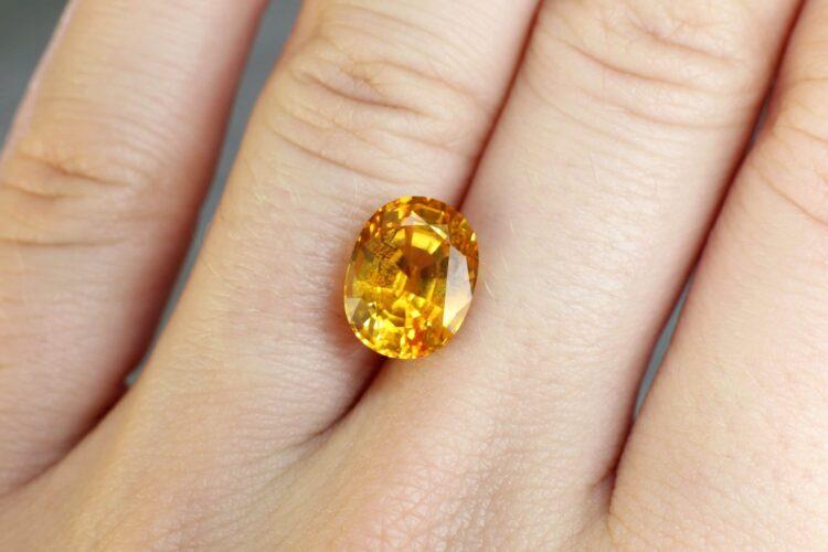 5.11 ct orangy yellow oval sapphire