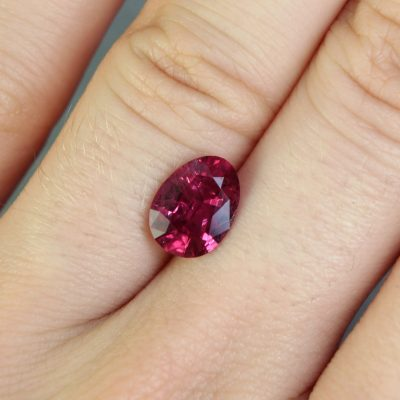 2.19 ct orangy purple red oval ruby