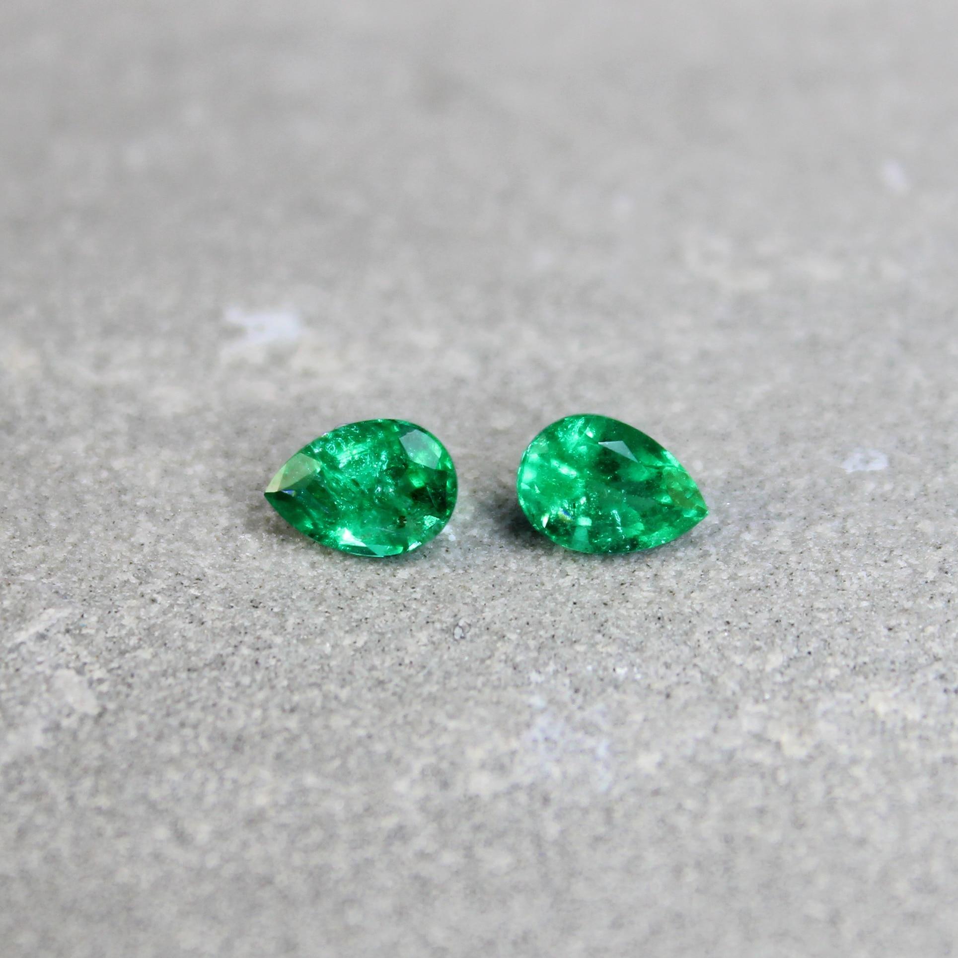 0.95 ct pear shape emerald pair