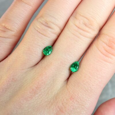 0.95 ct pear shape emerald pair