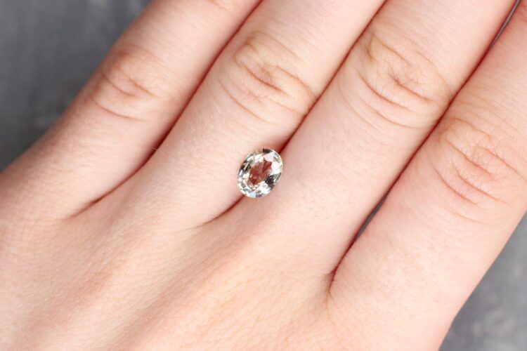 1.43 ct light orangy pink oval sapphire
