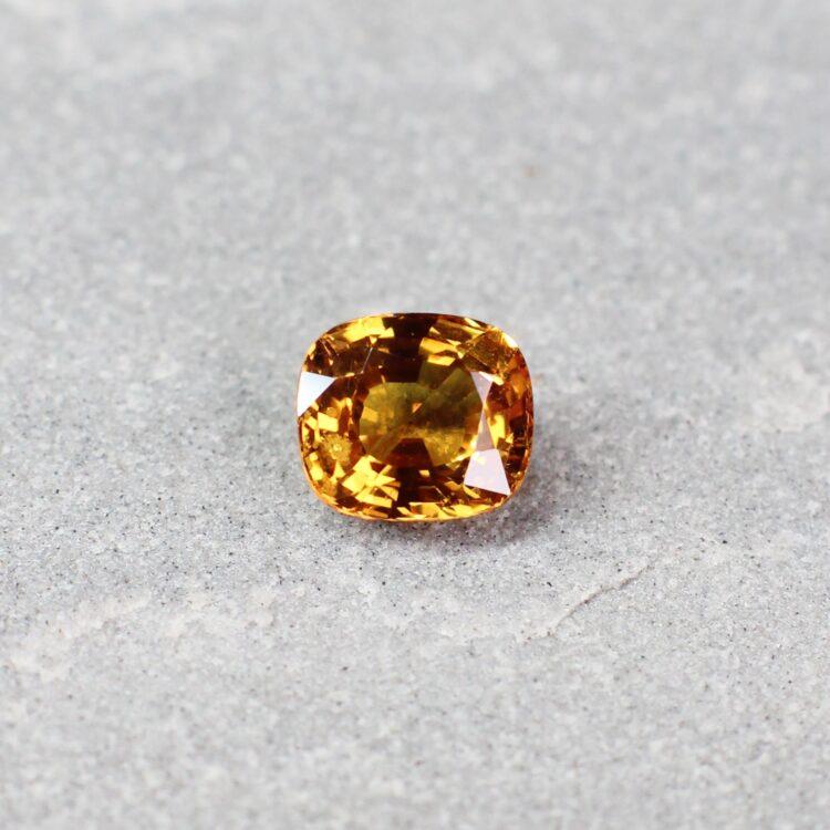 1.46 ct yellowish orange cushion sapphire