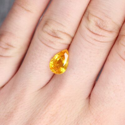 3.16 ct orangy yellow pear shape sapphire