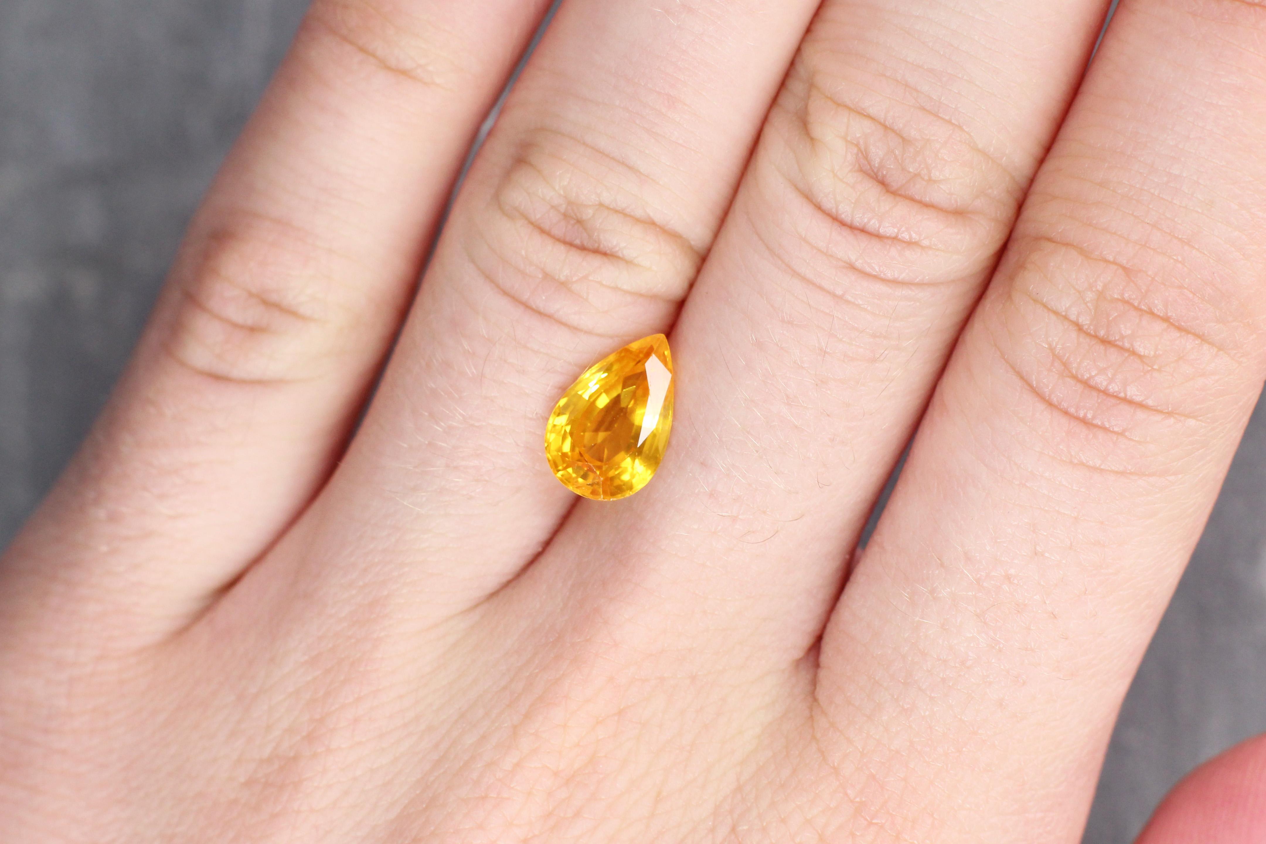 3.16 ct orangy yellow pear shape sapphire