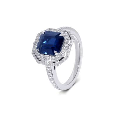 emerald cut sapphire and diamond ring in art deco style