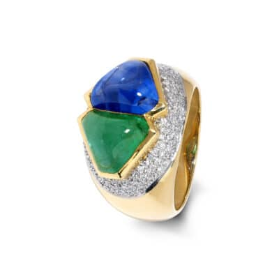 unique cabochon sapphire and emerald ring with pavé diamonds