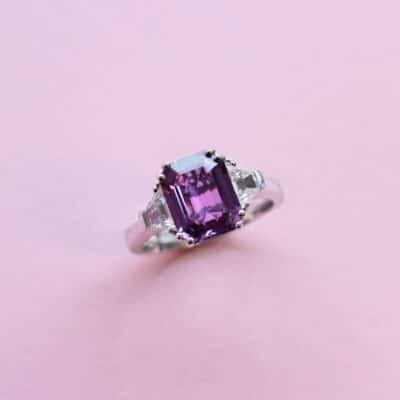 breathtaking purple sapphire and diamond white gold ring