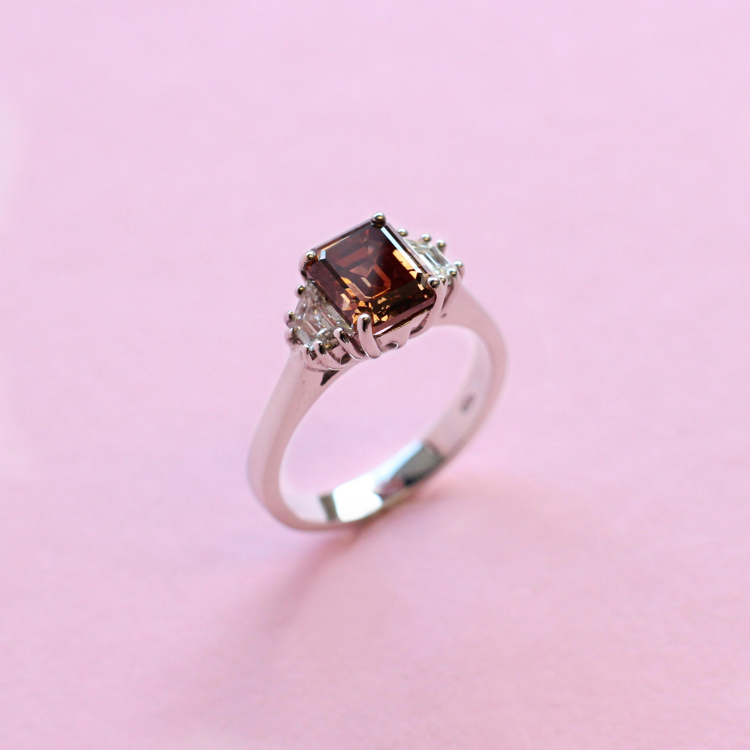 chocolate brown diamond ring with white diamond side stones