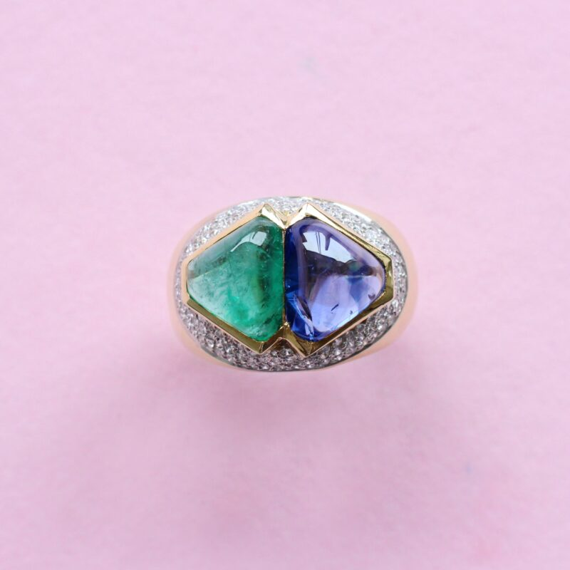 unique cabochon sapphire and emerald ring with pavé diamonds