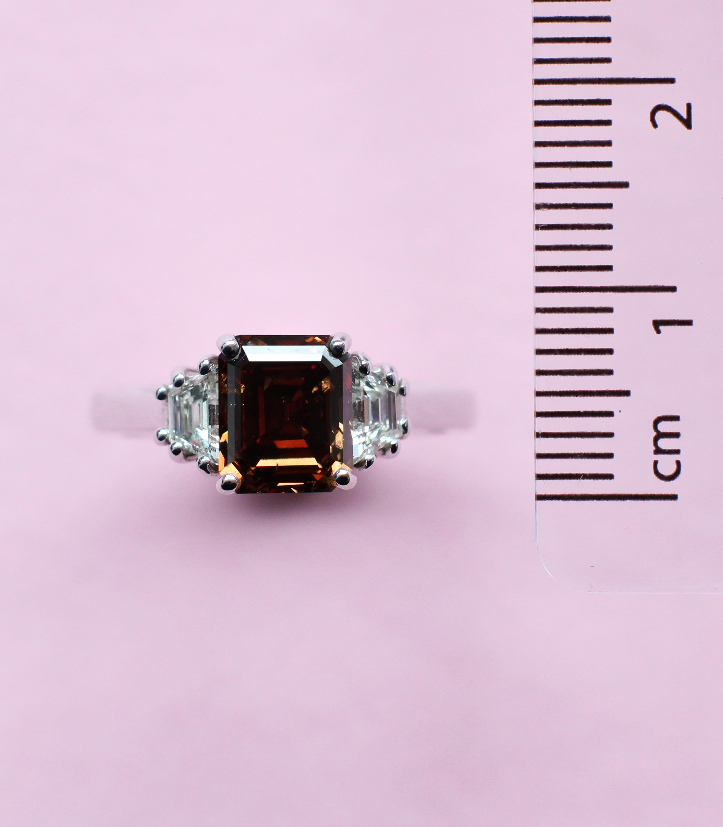 chocolate brown diamond ring with white diamond side stones