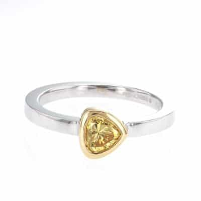 striking pear-shaped yellow diamond stacking ring