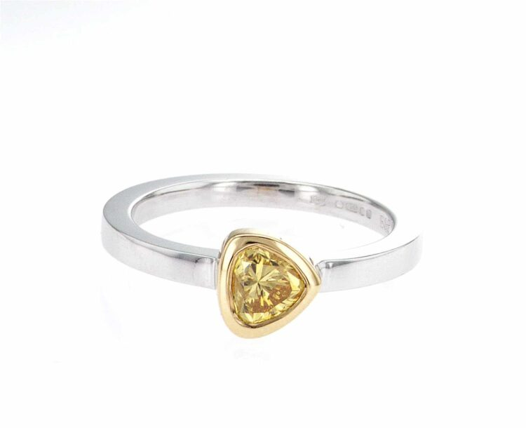 striking pear-shaped yellow diamond stacking ring