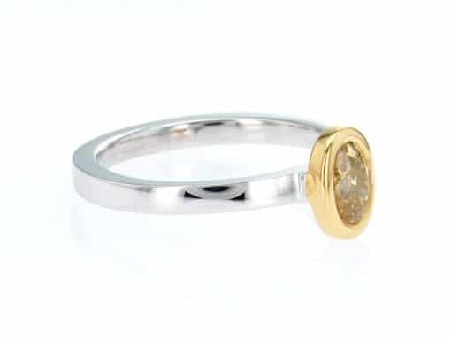 yellow oval diamond, white and yellow gold stacking ring