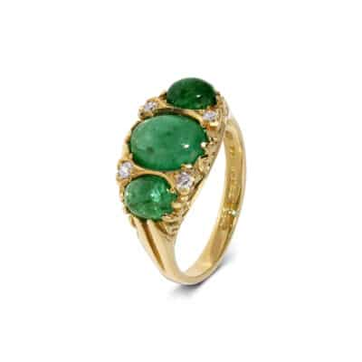 unique cabochon emerald ring with diamond detail