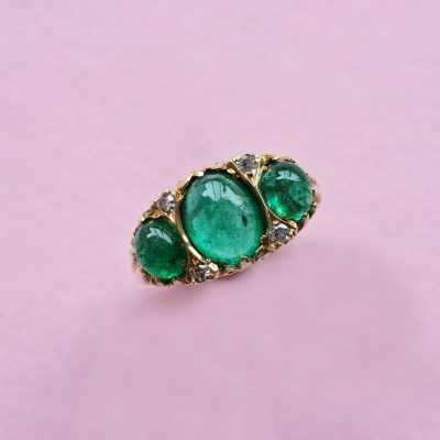 emerald oval cabochon three stone ring
