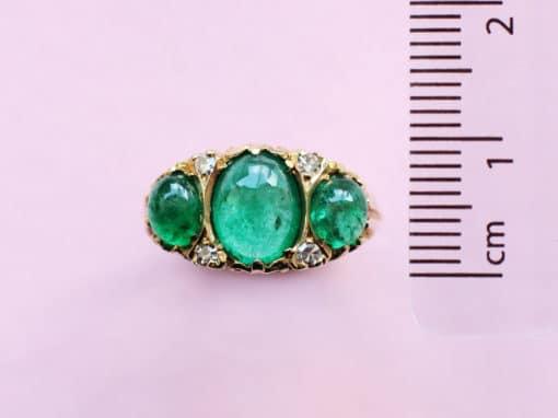 emerald oval cabochon three stone ring