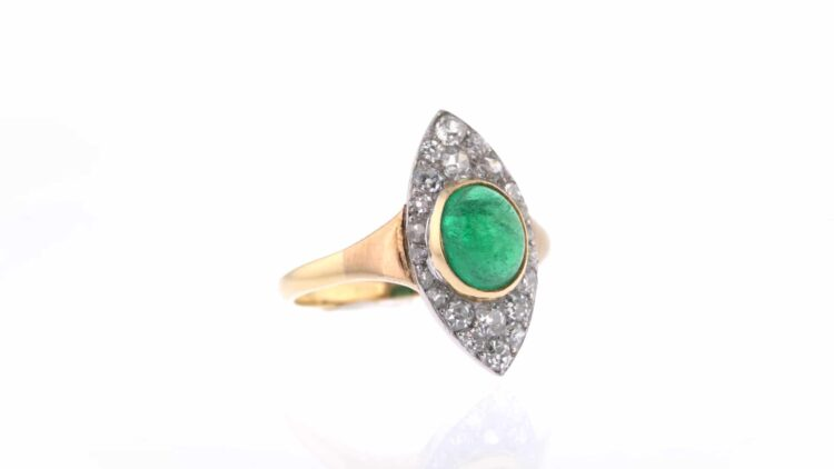 emerald cabochon ring with vintage-style diamond cluster