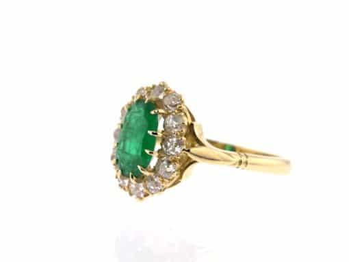 oval emerald, diamond surround and yellow gold ring
