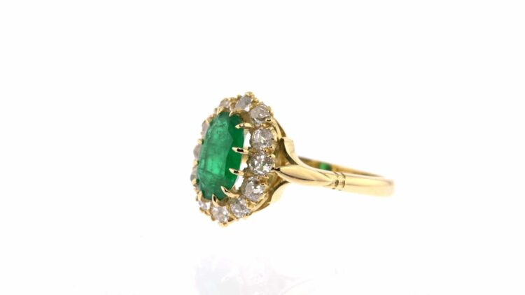 exquisite emerald ring with white diamond surround