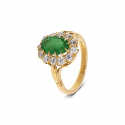 exquisite emerald ring with white diamond surround