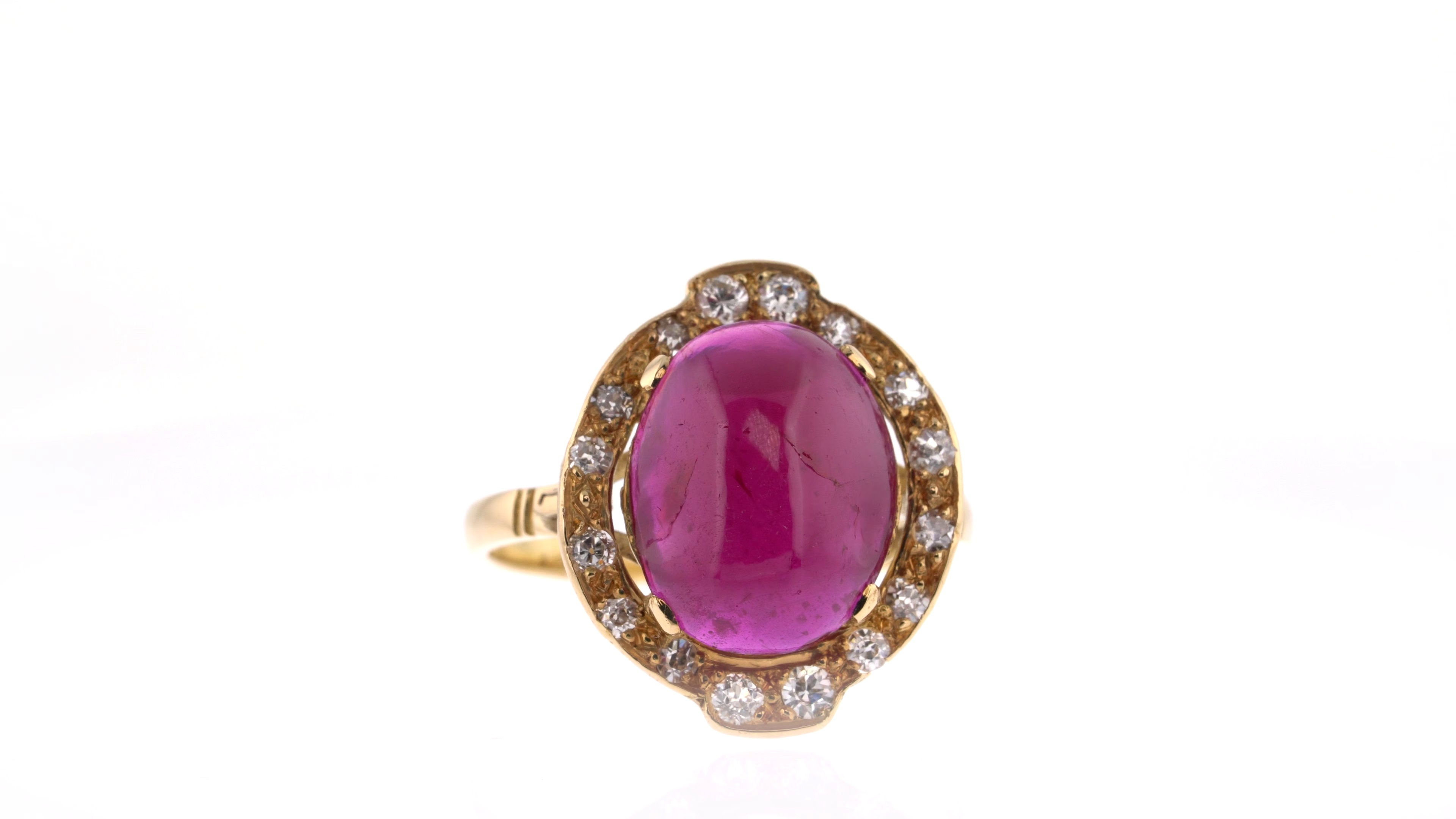 ruby cabochon ring with white diamond surround