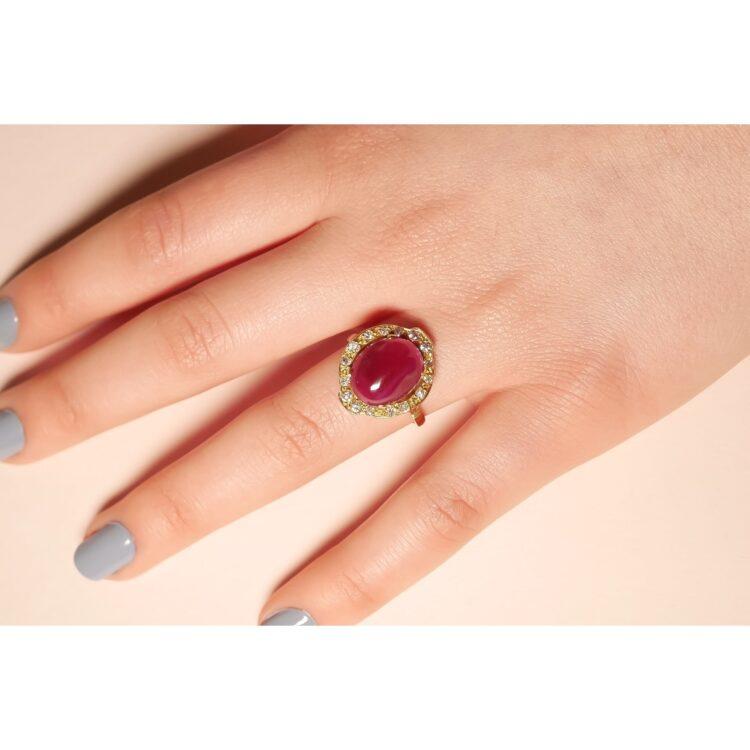 sensational pinkish red ruby ring with white diamond halo